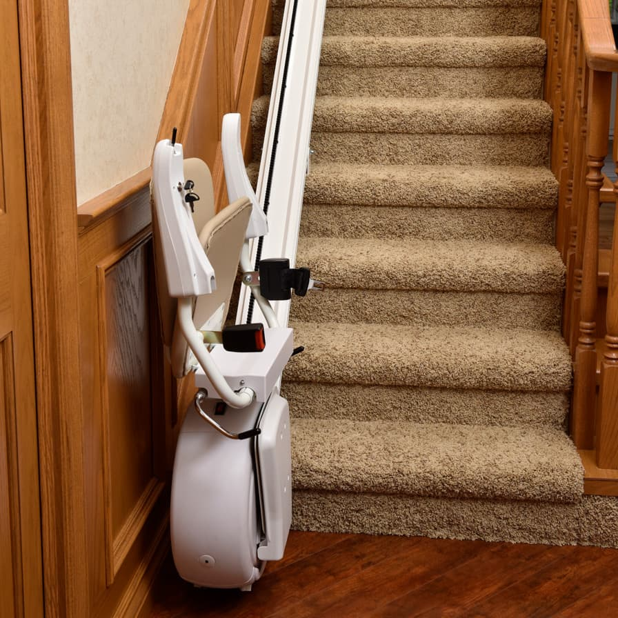 Savaria K2 Straight Stairlift Folded Up Bottom of Stairs