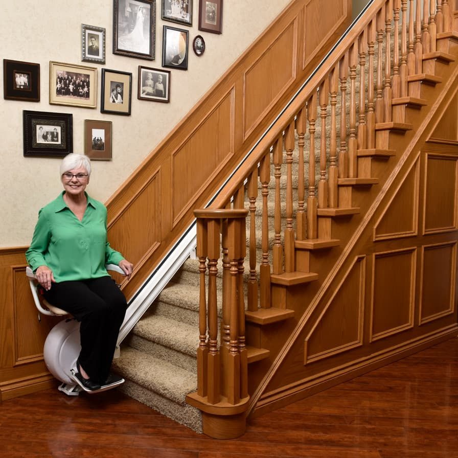 Savaria K2 Straight Stairlift Model Bottom of Stairs Wide Shot