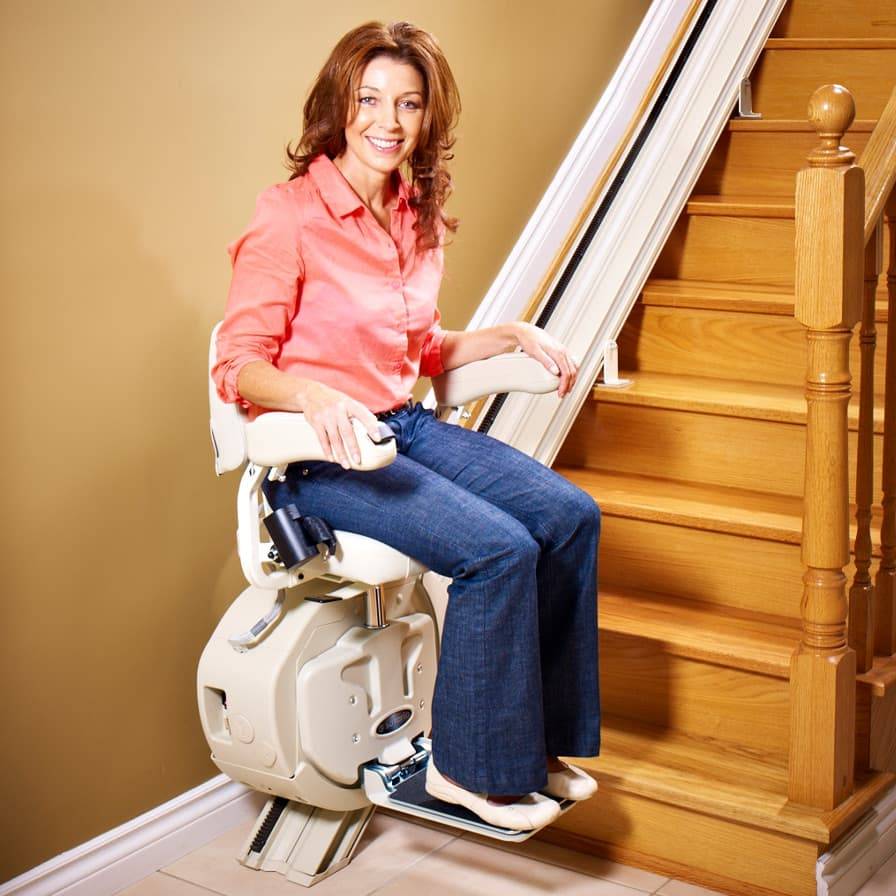 Savaria SL-1000 Stairlift model at bottom of stairs