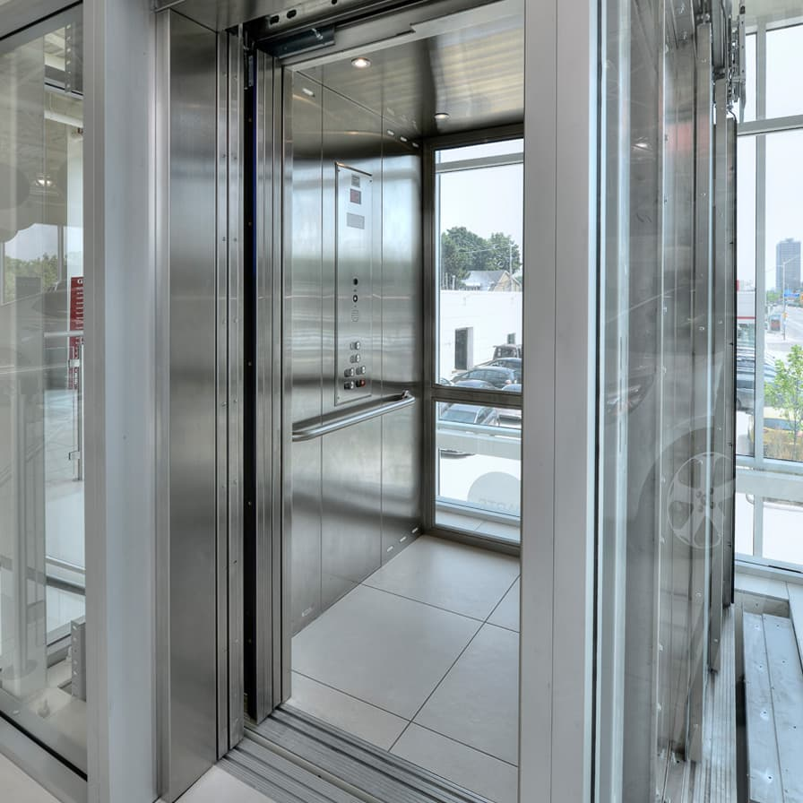 Savaria Orion Glass and Stainless Steel Cab Straight Through Commercial Elevator